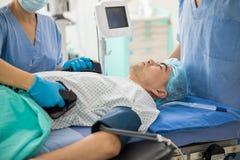 Doctors resuscitating a patient Stock Image