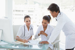 Doctors reviewing notes together Stock Images