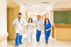 Doctors running during an emergency royalty free stock photography