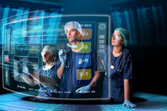 Doctors with screens. Doctors in a research station with digital  screens and keyboard Stock Image