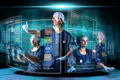 Doctors with screens. Doctors in a research station with digital  screens and keyboard Royalty Free Stock Images