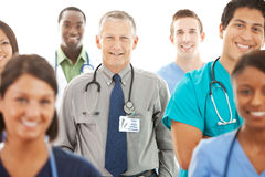 Doctors: Senior Doctor Leads Group of Physicians stock photos