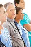 Doctors: Senior Male Doctor in Line of Physicians Royalty Free Stock Photos