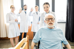 Doctors and senior patient Royalty Free Stock Image