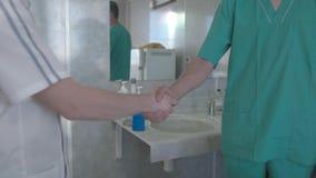 Doctors shake hands stock video footage