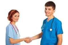 Doctors shaking hands Stock Photos