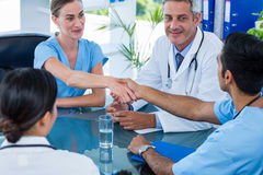 Doctors shaking hands during a meeting Stock Photos