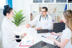 Doctors shaking hands Royalty Free Stock Photo