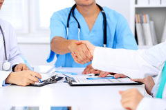 Doctors shaking hands to each other finishing up medical meeting Royalty Free Stock Photo