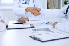 Doctors shaking hands to each other finishing up medical meeting Stock Images