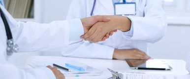 Doctors shaking hands to each other finishing up medical meeting Stock Photo