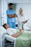 Doctors showing medical report to patient stock image