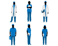 Doctors silhouettes on white Royalty Free Stock Photography