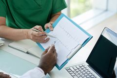 Doctors with cardiogram Stock Images