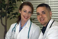 Doctors Smiling Stock Photography