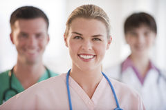 Doctors Smiling at Camera Stock Photo