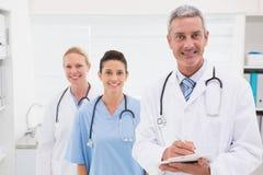 Doctors smiling at camera Stock Photos