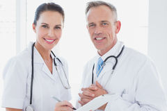 Doctors smiling and working together Stock Images