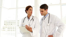 Doctors speaking about a file stock footage