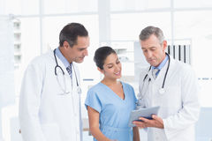 Doctors speaking with nurse Royalty Free Stock Photo