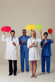 Doctors with speech bubbles Royalty Free Stock Photo