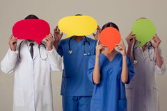 Doctors with speech bubbles Stock Photography