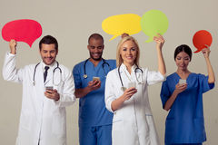 Doctors with speech bubbles Stock Photo