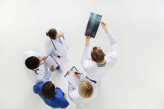 Doctors with spine x-ray and clipboards Stock Photos