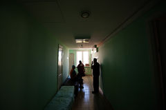 Doctors stand in the corridor after an operation. Royalty Free Stock Photo