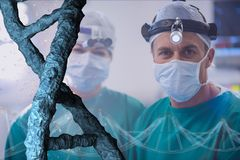 Doctors standing with 3D DNA strands. Digital composite of Doctors standing with 3D DNA strands Royalty Free Stock Images