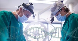 Doctors standing with 3D DNA strands Stock Image