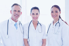 Doctors standing beside each other Stock Images