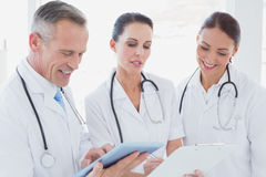Doctors standing beside each other Stock Photography