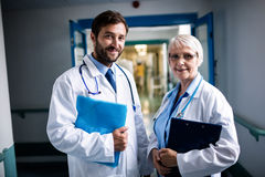 Doctors standing together with clipboard and file royalty free stock image