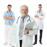 Doctors standing on white background, portrait Royalty Free Stock Photo