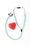 Doctors stethoscope and one red heart on white background Royalty Free Stock Photos