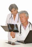 Doctors with stethoscopes looking at x-ray Royalty Free Stock Image