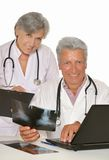 Doctors with stethoscopes looking at x-ray Stock Photos