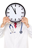 Doctors stress in front of the head with Clock. royalty free stock photography