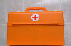 The doctors' suitcase. The orange doctors' suitcase on the white table Stock Photo