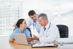 Doctors and surgeon discussing together Stock Photo