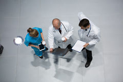 Doctors and surgeon discussing x-ray while having coffee Royalty Free Stock Photos