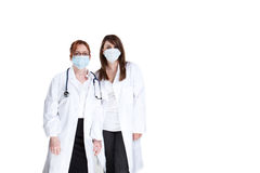 Doctors and surgical masks Royalty Free Stock Photos