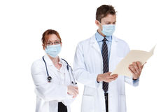 Doctors and surgical masks Stock Photo