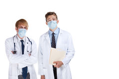 Doctors with surgical masks Stock Images