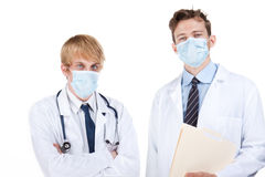 Doctors with surgical masks Royalty Free Stock Photography