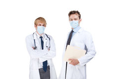 Doctors with surgical masks Stock Photography