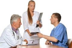 Doctors at  table exemining xray Royalty Free Stock Image