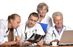 Doctors at the table  exemining xray Royalty Free Stock Photography