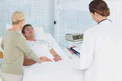 Doctors taking care of patient royalty free stock image